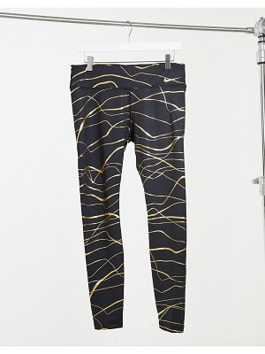 Nike Running fast tight leggings in black and gold