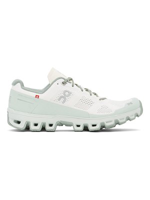 On white & green cloudventure sneakers