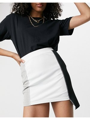 One Above Another body-conscious mini skirt set in patchwork with exposed stitching-multi