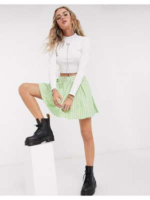 One Above Another mini pleated tennis skirt in green check