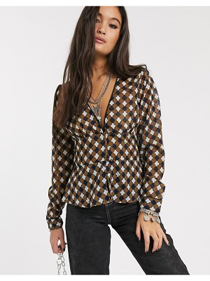 Only button through blouse in geo check-multi