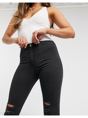 Parisian high waisted skinny jeans with ripped knees in black