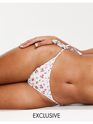 Peek & Beau fuller bust exclusive recycled polyester tie side bikini bottom in ditsy red floral print-multi