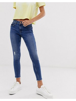 Pieces skinny jeans with raw hem in mid blue wash
