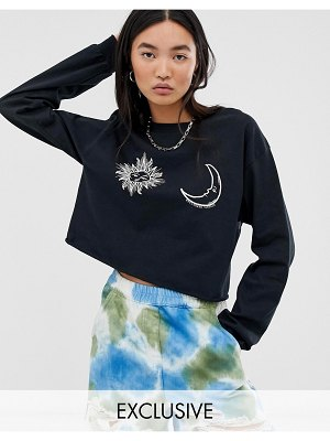 Reclaimed Vintage inspired cropped long sleeve t-shirt sun and moon faces print
