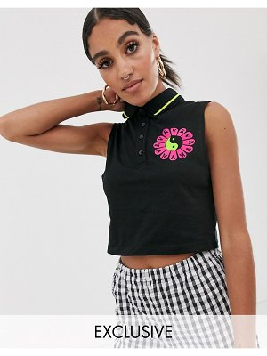 Reclaimed Vintage inspired sleeveless cropped polo with daisy logo-black