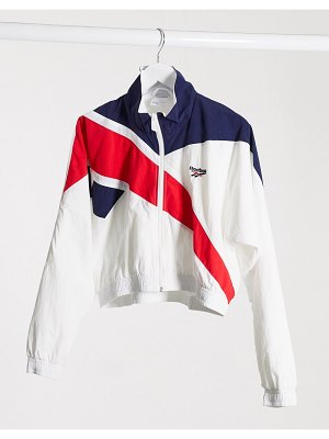 Reebok vector cropped track top in pink