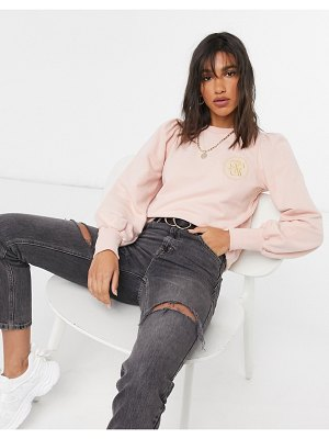 River Island puff sleeve emblem sweatshirt in pink