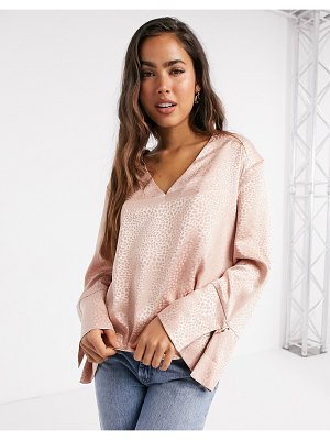 River Island satin relaxed luxe v-neck blouse in pink