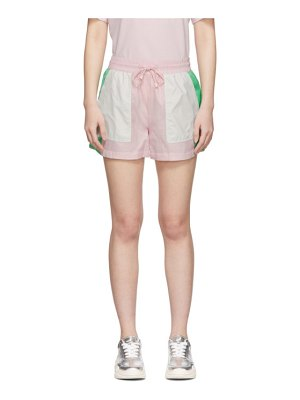SJYP pink and green colorblock windbreaker track shorts