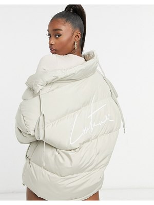 The Couture Club signature padded jacket in beige-blues
