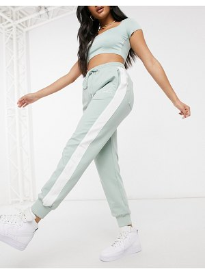 The Couture Club sporty stripe sweatpants in green