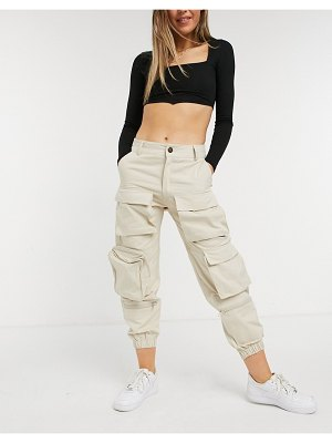 The Kript high waisted relaxed cargo pants in stone-beige