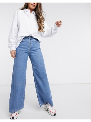 The Ragged Priest relaxed wide leg skater jeans in mid wash denim-blue
