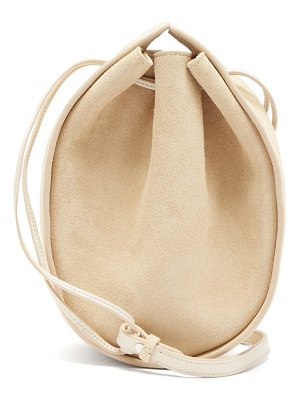 THE ROW drawstring round suede cross body bag