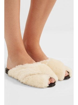 Trademark shearling and leather slides
