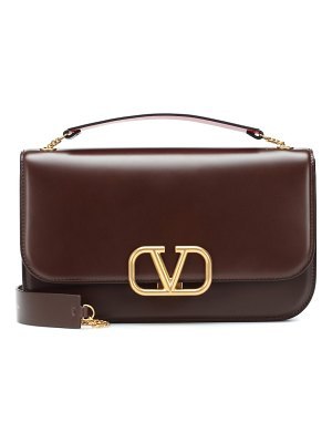 Valentino valentino garavani vlock medium leather clutch