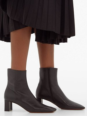 VETEMENTS boomerang square toe leather ankle boots
