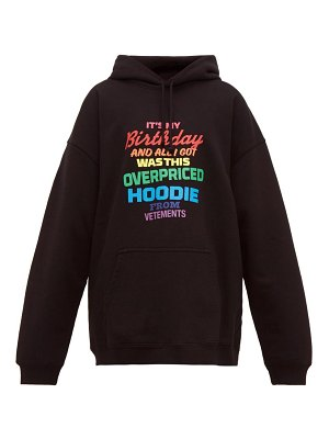 VETEMENTS slogan print cotton jersey hooded sweatshirt