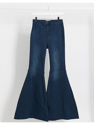 We The Free by Free People just float on high waist flare jeans in indigo-blue