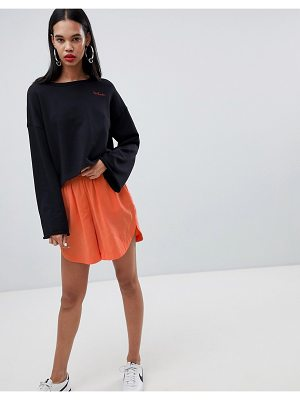 Weekday peach feel shorts in orange and red