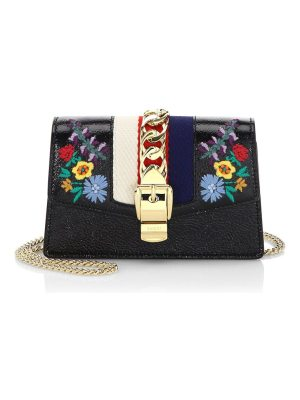 Gucci embroidered floral leather clutch